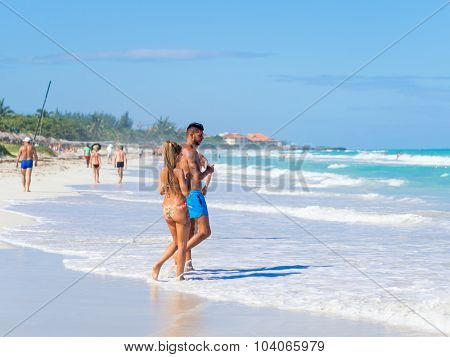 VARADERO,CUBA - OCTOBER 3, 2015 : Tourists at the beautiful beach of Varadero in Cuba