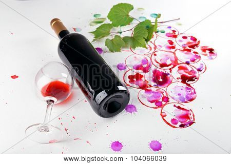 Grapes painted with wine cork and goblet and bottle of wine