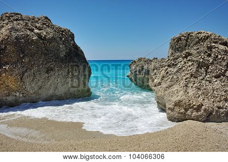 Rocks in the blue waters of Megali Petra Beach, Lefkada