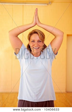 Woman Folding Hands In Gym