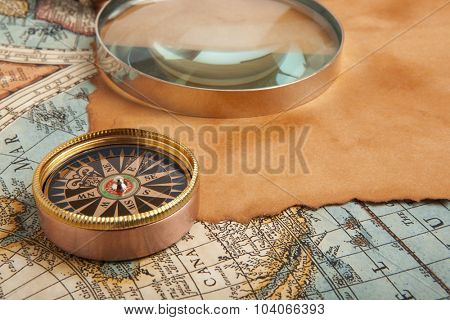 Old compass on vintage retro map 1687