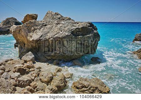 Big Rock in the blue waters of Megali Petra Beach, Lefkada