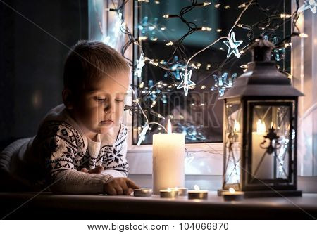 Child at Christmas eve and New Year