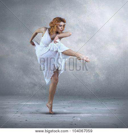Dance element of ballerina in white dress