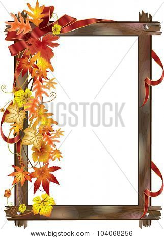 Autumn leaves in the wood frame with a red ribbon