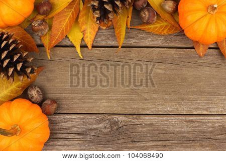 Autumn corner border against rustic wood