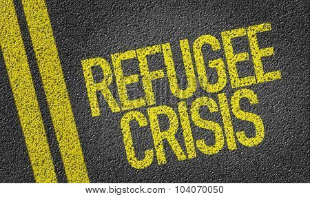 Refugee Crisis written on the road