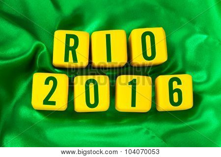 SAO PAULO, BRAZIL - CIRCA OCTOBER 2015: Rio 2016 written on yellow cube on green background