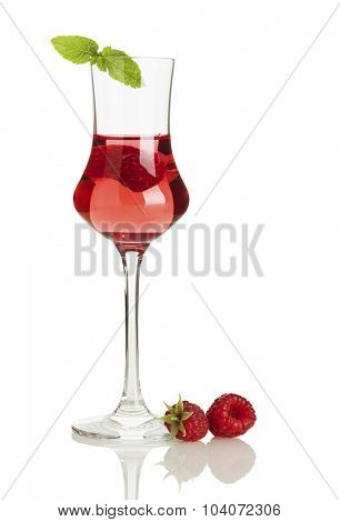 Glass of raspberry liqueur with berries isolated on white background