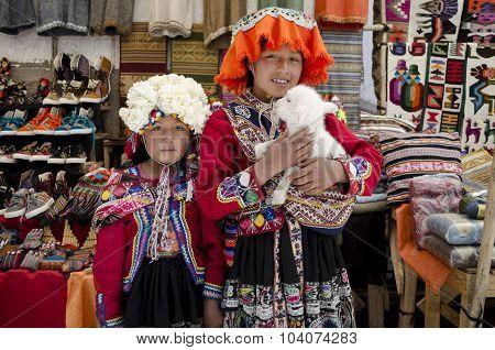 Children with a lamb at Pisac market in Peru