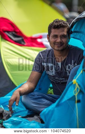 KOS, GREECE - SEP 28, 2015: Unidentified war refugee. More than half are migrants from Syria, but there are refugees from other countries -Afghanistan, Pakistan, Iraq, Iran, Mali, Somalia.