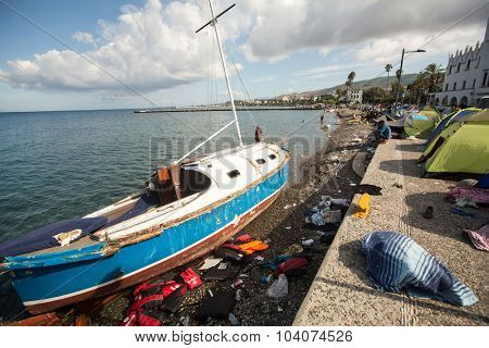 KOS, GREECE - SEP 27, 2015: Life Jackets discarded and sunken Turkish boat in the port. Kos island is located just 4 kilometers from the Turkish coast, and many refugees come from Turkey in an boats