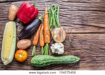 Fresh organic vegetables on the wooden table. Top view.
