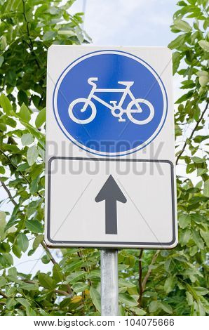 Blue Bicycle Lane Sign With Sky And Trees Background