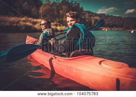 Happy couple on a kayaks