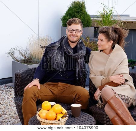 Cheerful couple on a terrace on autumn day