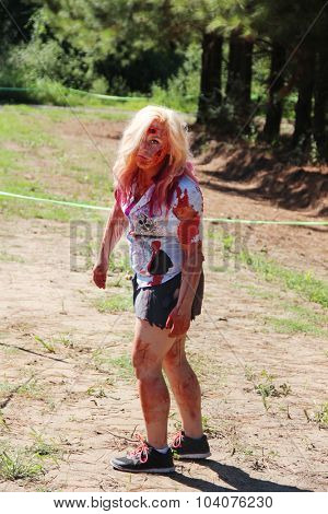MUSKOGEE, OK - Sept. 12: An actor dressed as zombie waits for the next runner during the Castle Zombie Run at the Castle of Muskogee in Muskogee, OK on September 12, 2015.