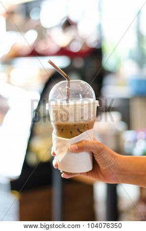 Cold Coffee In Plastic Cup, Blur Coffee Bar Background