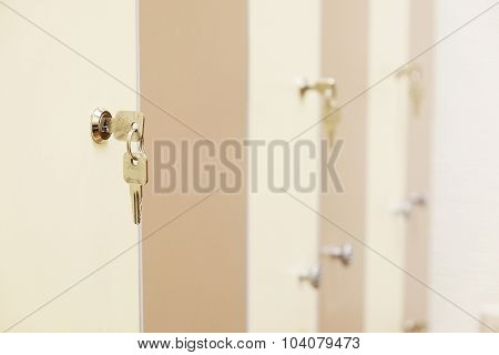White umbrella on a closed doors in a cloak-room