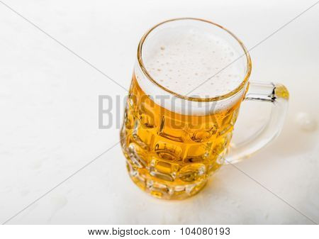 Mug of beer Top view Close-up White background.