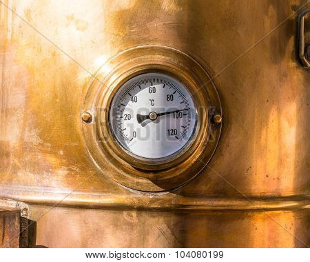 close-up vintage pressure gauge on vessel