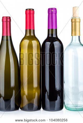 Four wine bottles isolated on white background.