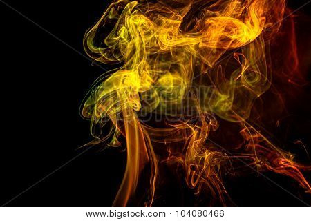 Abstract Yellow - Green - Orange Smoke From Aromatic Sticks.