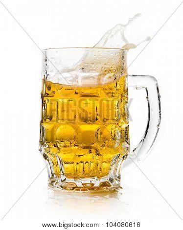 Beer splashing in glasses on white.
