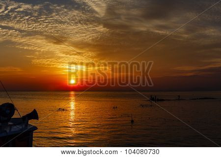 Ocean Landscape At Sunset. Silhouettes Of Fishermen And Fishing Craft.