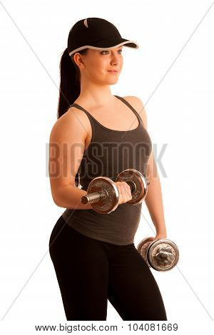 Beautiful young woman posing with dumbels in front of white background