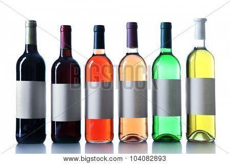 wine bottles in a row isolated on white background