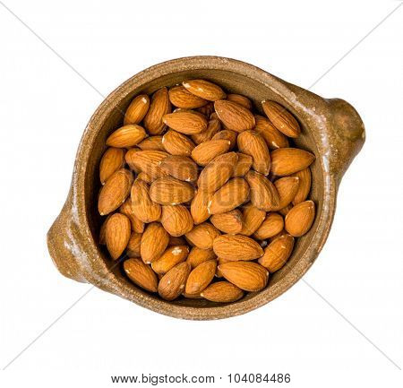 almonds in a ceramic plate isolated on white background