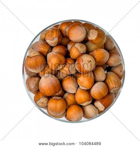 hazelnuts in a glass cup isolated on a white background