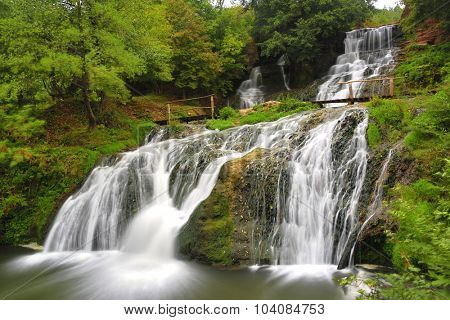 Majestic waterfall in autumn forest
