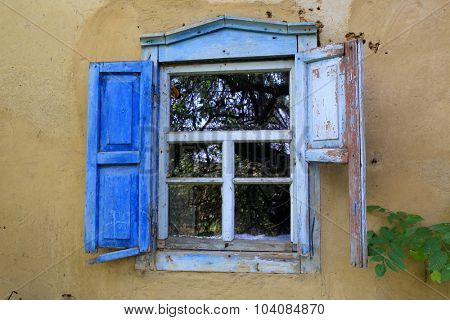 Old window in abandoned rural house