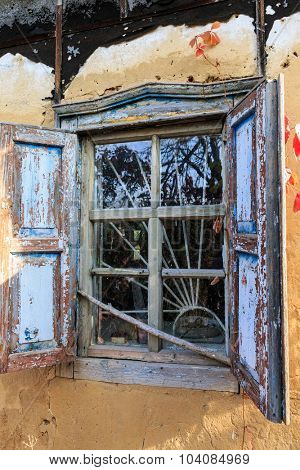 window of old abandoned rural house. Take it in Ukraine, near Poltava City