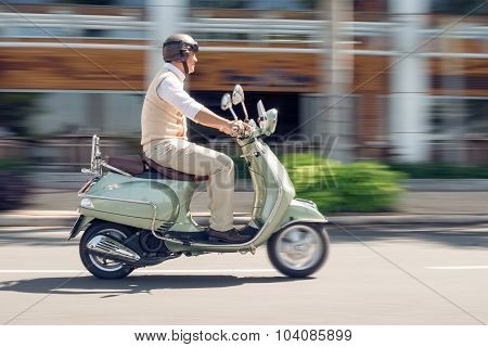 Senior On Scooter