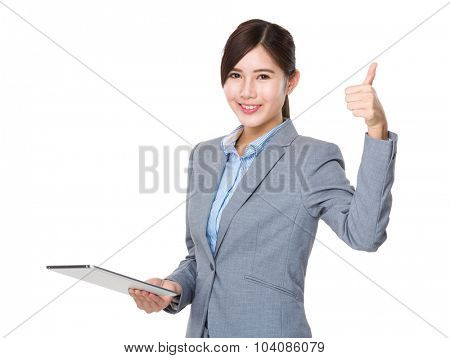 Businesswoman use of the tablet pc and thumb up