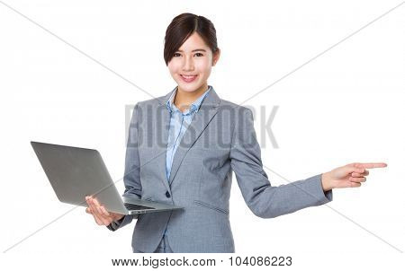 Asian Young Businesswoman use of the laptop computer and finger point aside