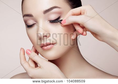 Makeup Artist Glues Eyelashes