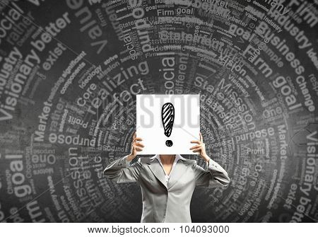 Businesswoman hiding her face behind paper list
