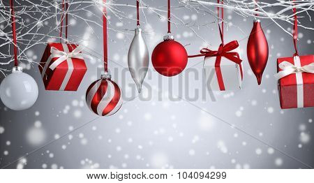 Christmas balls and gifts hanging on branch
