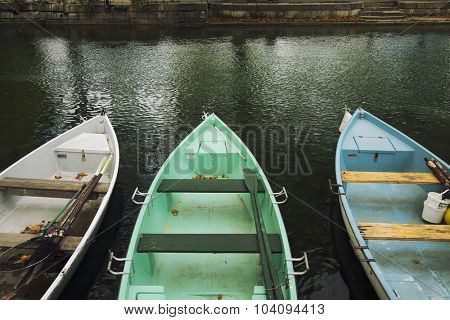 Detail of colourful rowing boats with oars, moored at the riverside in Annecy, France
