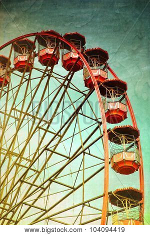 Vintage retro red ferris wheel.  Cross processed to look like and instant picture with texture. instagram style