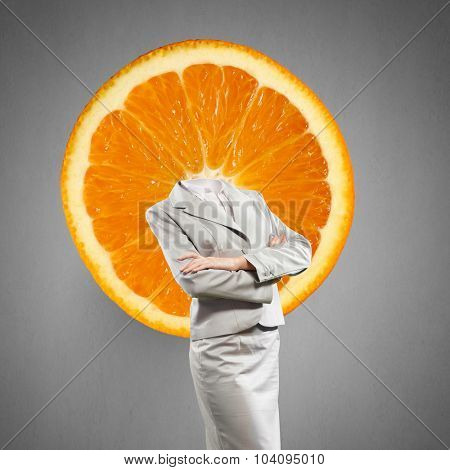 Headless businesswoman with orange instead of head