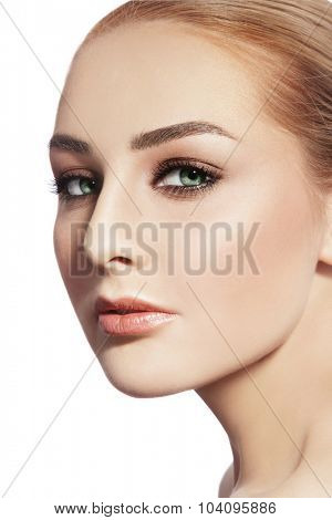 Close-up portrait of young beautiful healthy woman with stylish make-up over white background, copy space