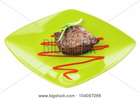 meat food : roast beef fillet mignon served on green plate with chives and ketchup isolated over white background