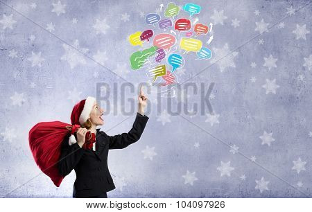 Santa woman with red bag on back pointing up with finger