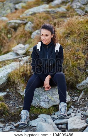 Woman With Backpack Resting