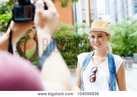 Young woman in city posing for a photo
